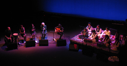 Duquende and his Flamenco group (left) did a duet with Faiz Ali Faiz and his Qawwali group (right) on the opening night.   image